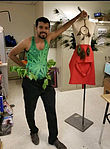 Bio-Dresses. 1. Swimsuit tucked inside pants decorated with durable leaves. 2. A space-suit style wing made of parts of Christmas tree and peacock feather