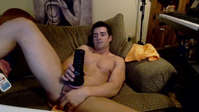 Athletic College Guy Uses Fleshlight with Dildo in Hole