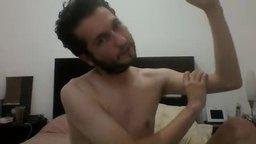 Twink Model Joe Squeezes Biceps