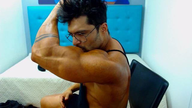 Dennis Licks His Biceps