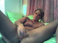 fucks huge dildo into pierced pussy