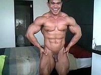 Oiled Bodybuilder Flexing
