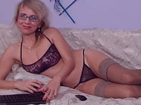 Older Blonde in Stalkings and Glasses