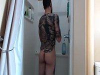 Tattoo Guy Riding Dildo in Webcam Shower