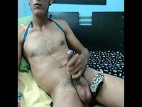 Latino Male Mobby Plays with a Dildo