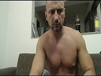 Alexandros Jerks His Cock While Sitting on a Couch