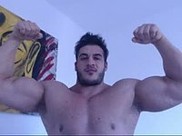 Vodo Flexes His Muscular Body