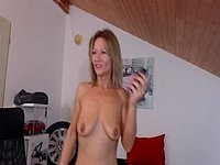 Cougar Plays with Her Clit