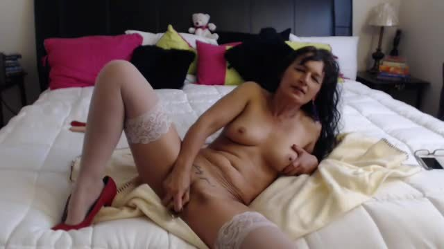 Mature Lady with a Dildo
