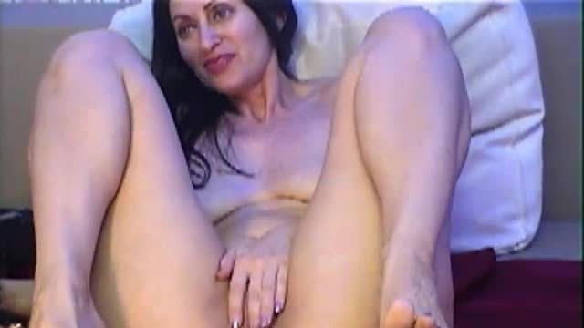 Brunette Strips and Plays with Pussy