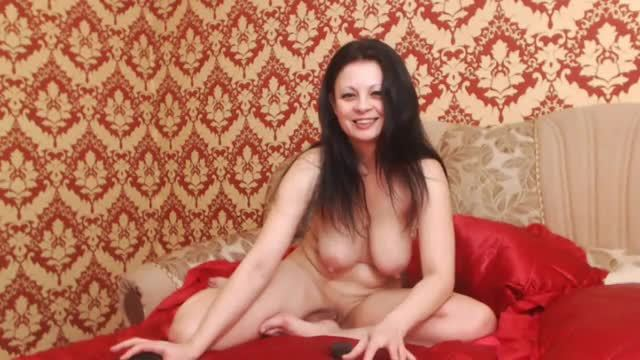 Large Breasted Gal Plays with Red Dildo