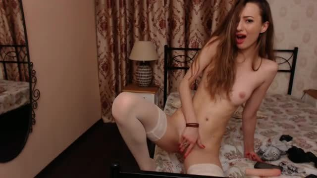 Skinny Redhead Fucks in Stockings
