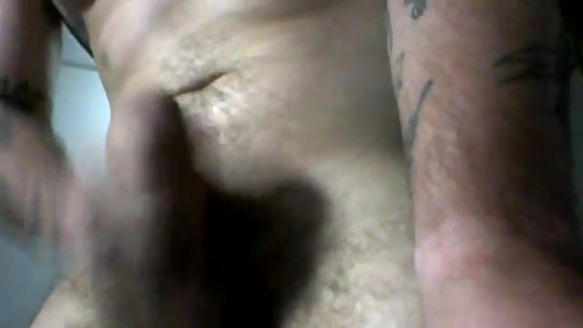 Tattooed Muscle Guy Strokes His Cock