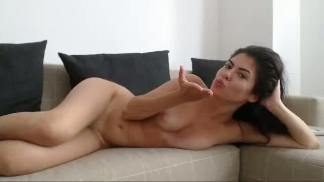 Sexy Brunette Moves Around with Toy Inside