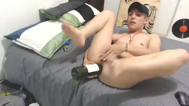 College Model Playing with a Bottle on His Ass