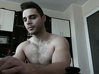 Muscled Hairy Chested Guy Strokes to Completion